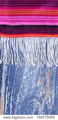 Close up of colorful serape with fringe for Cinco de Mayo holiday concept. Vertical layout.