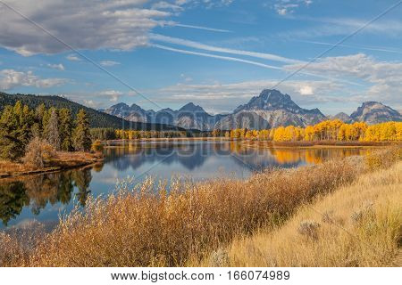 a scenic reflection of the Tetons in Wyoming in autumn