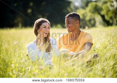 Young mixed ethnic couple together in nature