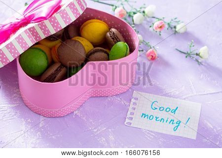Mug Cakes Macaron, Leaf Notebook Inscription Good Morning On Purple Table Top. The Cozy Breakfast. C