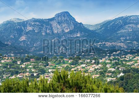 Scenic countryside of Saint-Paul-de-Vence in France with the Maritime Alps mountains in the distance.