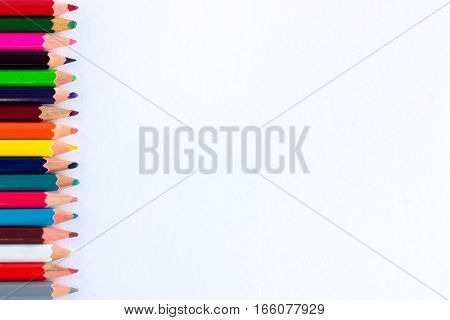 White Background For Presentation With Vertical Colorful Border Of Pencils