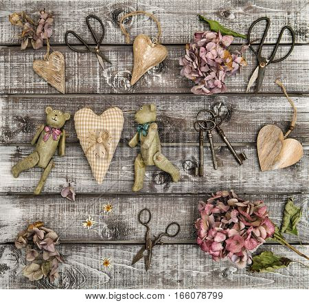 Vintage toys hortensia flowers and wooden hearts. Nostalgic flat lay. Retro style still life