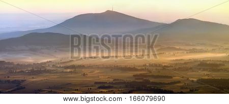 Panorama of Sleza mountain in sunrise light Poland