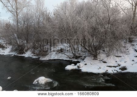 Snow drifts on the river in winter