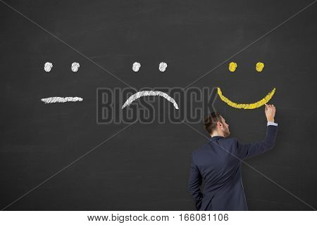 Unhappy and happy on chalkboard background working
