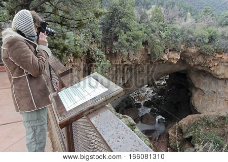 A Woman Photographs Pine Canyon and Tonto Natural Bridge from Viewpoint #1