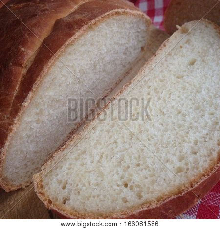 delicious freshly baked bread from leavened dough of wheat flour and sliced