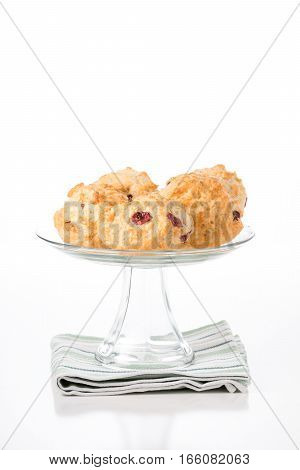 Fresh lemon cranberry scones on a glass presentation platter.