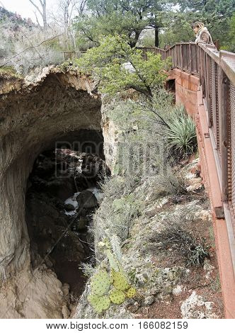 A Woman Gazes Down from the Tonto Natural Bridge State Park Viewpoint #4 Over Pine Creek