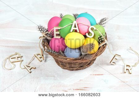 Easter eggs with decoration on bright wooden background