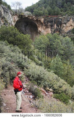 A Man Hikes into Pine Canyon on Gowan Trail Towards Tonto Natural Bridge