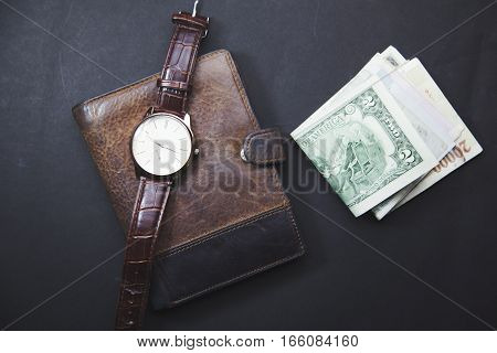 Classic Watches money on brown wallet table