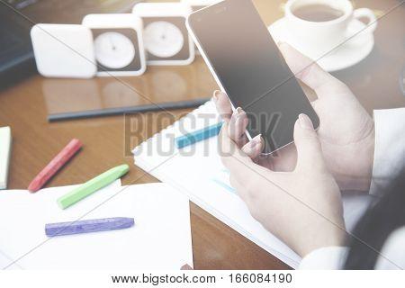 woman hand phone idea writing on notebookpencilcoffeeglasses on table