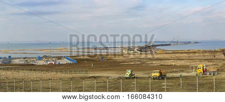 TUZLA TAMAN PENINSULA RUSSIA - JANUARY 04.2017: Machinery on the construction site of a bridge across the Kerch Strait from the Taman.
