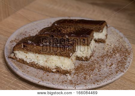 Chocolate cake `Bounty`  with coconut on wood background