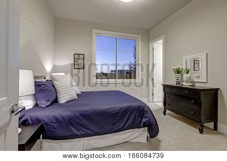 Beige And Pale Gray Bedroom Design Accented With Blue Bed
