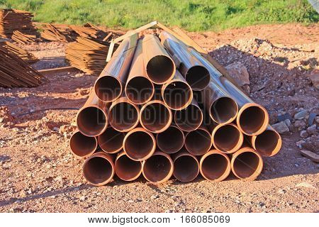 Plastic pipes on a road construction site