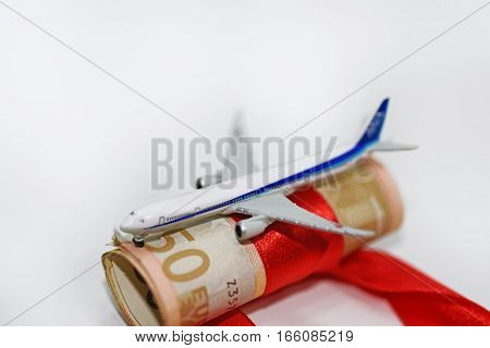 Abstract photo of traveling on passenger aircraft. Euro money abstraction.