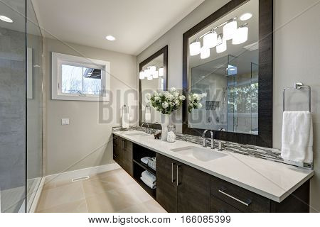 Spacious Bathroom In Gray Tones Wizth Long Vanity