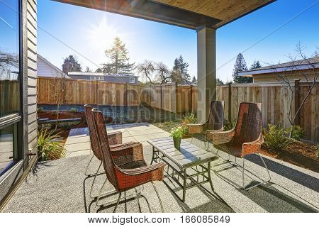 Backyard Covered Patio Design With High Back Wicker Chairs