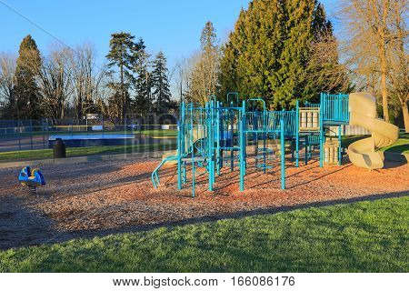 Children Playground Activities Surrounded By Green Trees