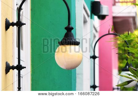 Wall lights on european architecture in the city of macau china at fisherman's wharf.