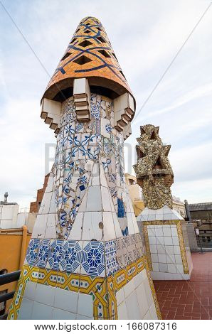 Barcelona, Spain - September 20, 2014: Design of the roof of Palace Guell - Gaudi Chimney: broken tile mosaics and strange decorated chimneys are evident in his early work.