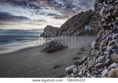 Carabeo beach at sunset with fishing hut Nerja Malaga Spain