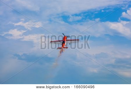 Flying in the sky on a background of clouds the plane SU 31.