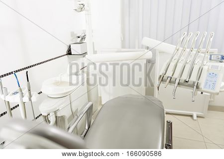 Your dental treatment are quick and comfortable in new convenient office of stomatologist. Grey soft chair, electronical instruments and equipments are in apartment of odontologist