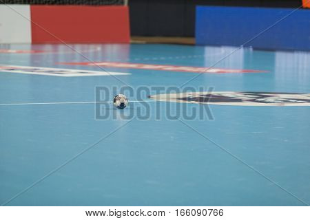 Handball - Stock image A ball in the middle of the field.