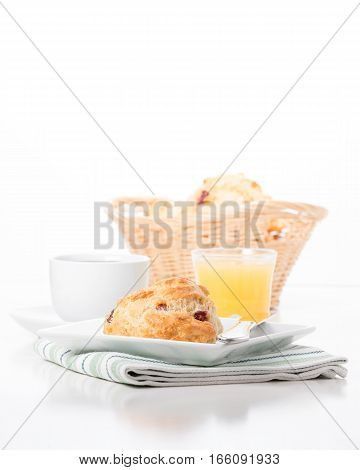 Fresh cranberry lemon scones served with coffee and juice.