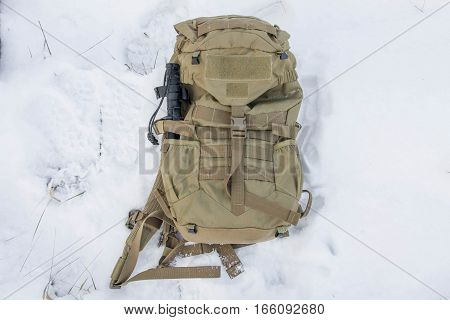 Tactical backpack with a knife. Backpack sand color.