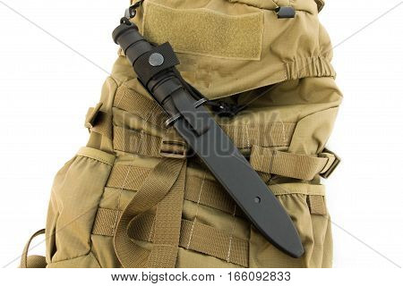 Tactical knifea in case. Backpack sand color.