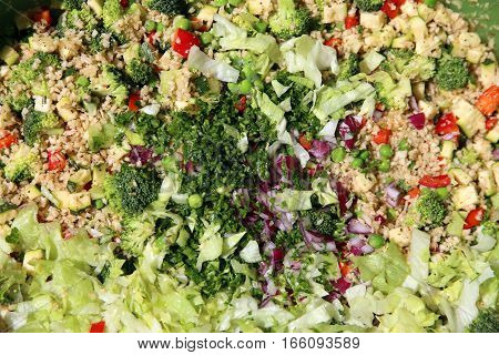 Colorful healthy salad ingredients on table as a background