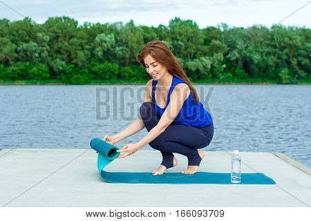 Young Woman Doing Yoga Exercise On Mat 43