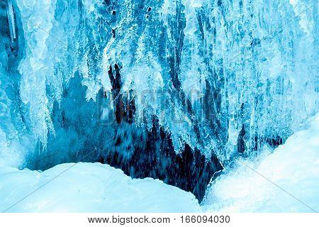 frozen small mountain blue waterfall close up