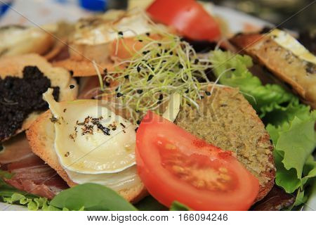 Goat cheese salad with tomato and egg plant caviar