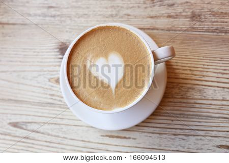 Morning cappuccino with love sign from the foam for loving people