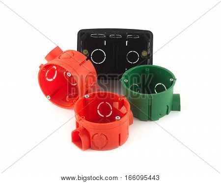 Color plastic containers for electric wiring mounting isolated on white closeup