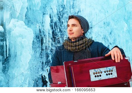 Young man With Harmonium. young man playing the harmonium
