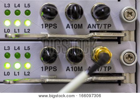 Equipment of radio base station close-up with green diods. Internet. Communication. Network