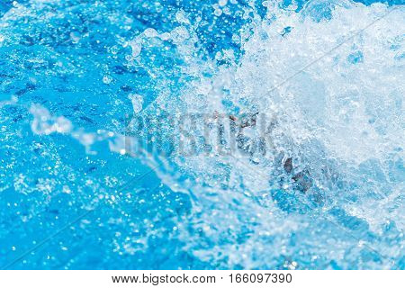 Water splashes from jumping into the water from a hill