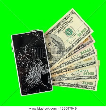 Smartphone with broken display lying on money banknotes Isolated on green chroma key background. Need new smartphone concept