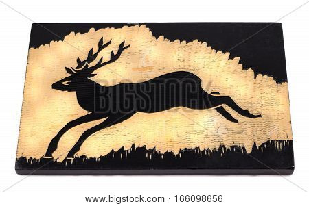 Crafts from wood burned deer on a wooden board