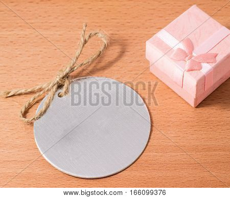 tag for clothes on a wooden background please enter your brand