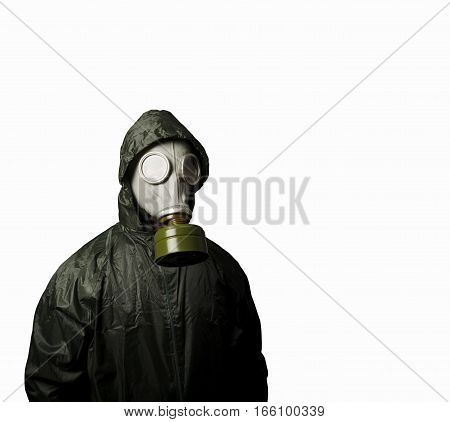 Man wearing a gas mask on his face. Gas mask on white background