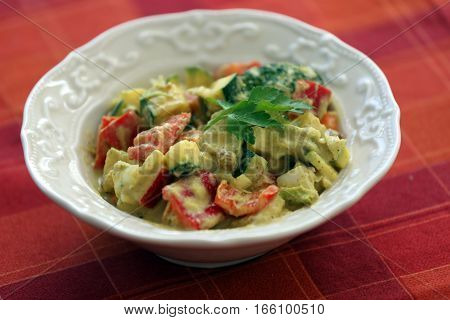 Homemade Salad With Spicy Dressing On Table