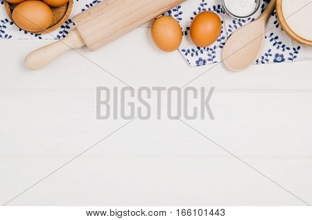 Baking a cake or pizza ingredients background. Top view photograph with kitchen utensils on vintage, natural, white, wooden background.